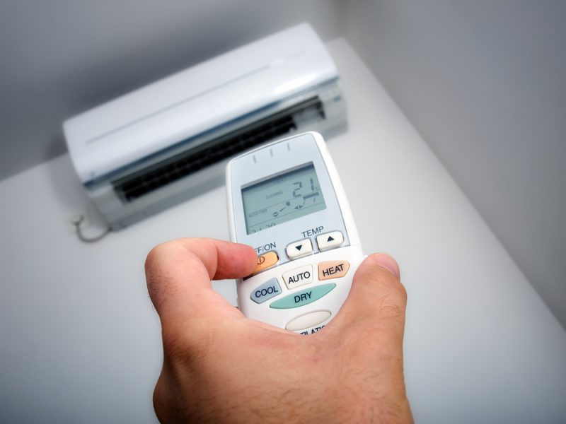 Closeup view about using some appliance such as air condition.